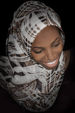 Beautiful girl wearing a headscarf and smiling, photo