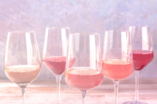 Various styles of rose wine, side view with a place for text, toned image