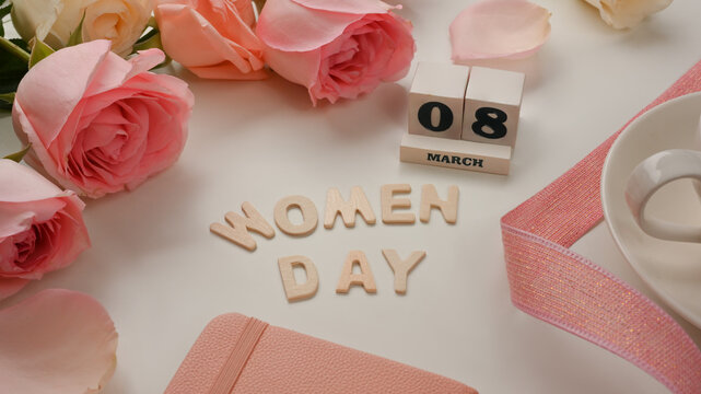 8 March Happy Women's day on white background decorated with pink flowers and ribbon