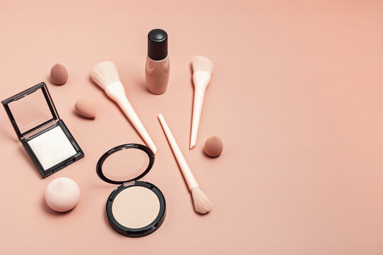 Set of pink make up brushes and beauty cosmetic products