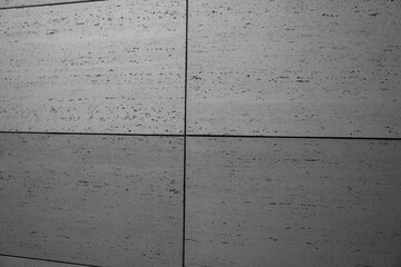 Obraz betonowa nowoczesna ściana pokryta szarymi betonowymi płytkami w stylu modern lub loft - fototapety do salonu