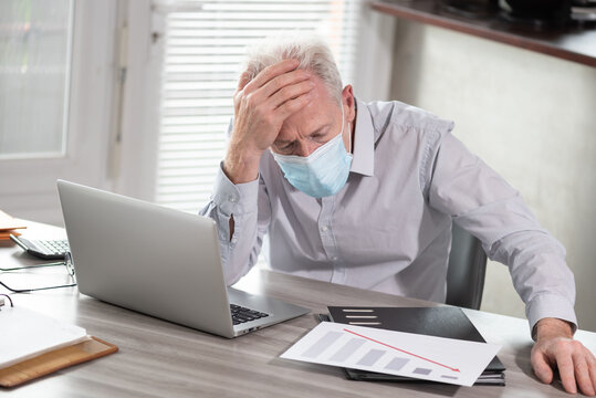 Stressed businessman; concept of economic crisis due to the coronavirus outbreak