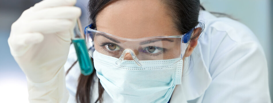 Panorama Female Laboratory Scientist or Doctor Wearing Face Mask in Lab With Test Tube