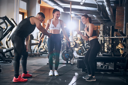 Cheerful friends having fun together during workout