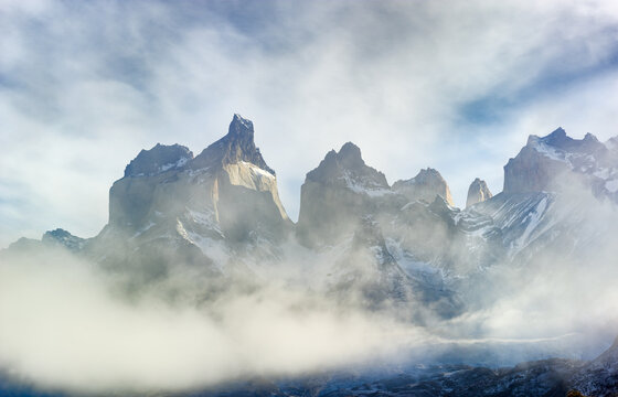 The peaks of Los Cuernos (The Horns) in Torres del Paine National Park shrouded in early morning fog