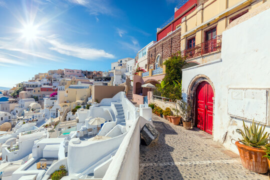 Famous Oia, Santorini, Greece. A picturesque view of the traditional Santorini  houses on a small street