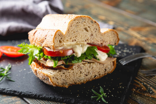 Large sandwich with turkey, vegetables and whole grain bread