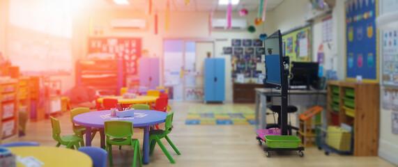 Obraz Kindergarten classroom school background. Class room for children students or nursery kids. Blur daycare preschool. - fototapety do salonu