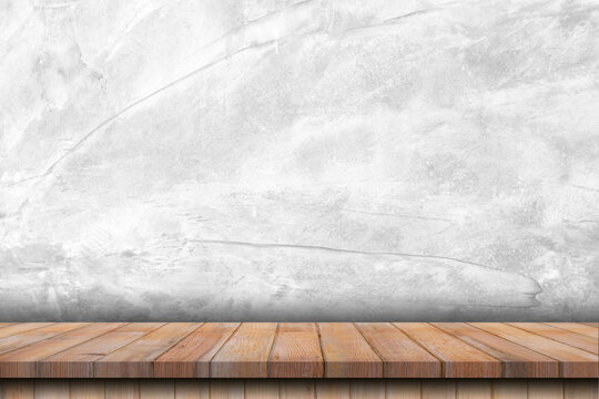 Empty wooden table and concrete wall texture and background with space