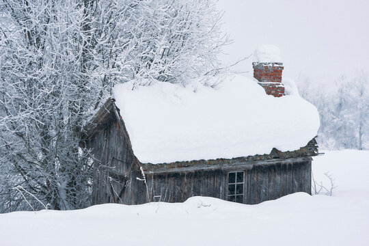 Old outdoor rough kitchen of an abandoned farm in winter.
