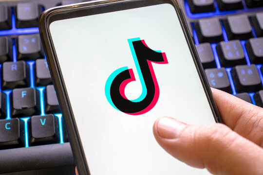 Tiktok logo with colorful background on smartphone. Social network for videos for young people close up. Verona, 13-02-21