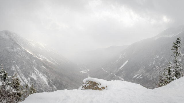 A snow squall passes through Crawford Notch in the NH White Mountains