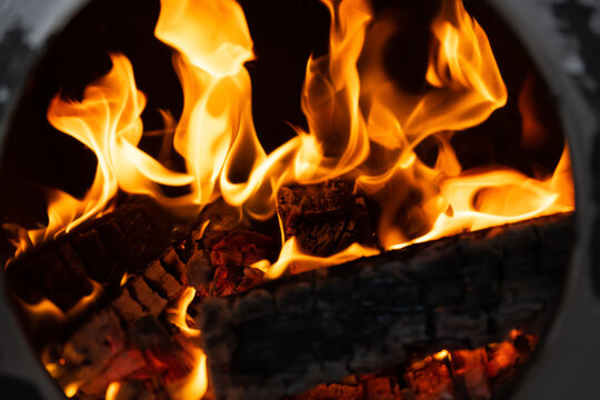Firewood burning in the stove, fire
