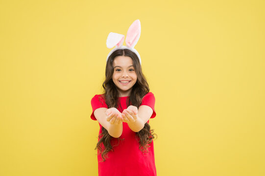 Look here. Little child celebrate Easter. Small child Easter style. Bunny child. Girl child wear rabbit ears. Spring season. Holiday celebration. Charismatic baby advertising easter topic