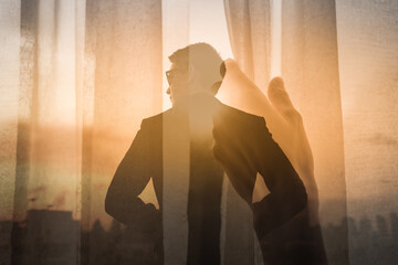 Fototapeta Young confident business man looking to the future. Opening curtain window to a new day. Progress and success concept.  obraz