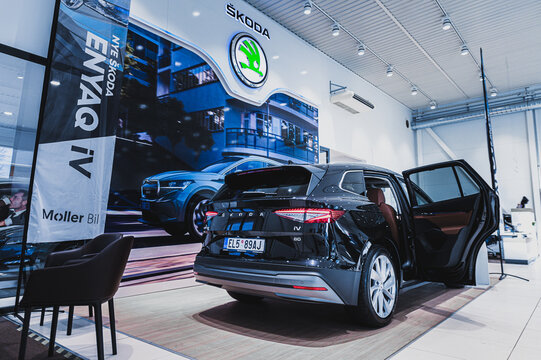 Tønsberg, Norway - February 11, 2021: black Skoda enyaq IV is a suv electric car. New car in car dealership show room.
