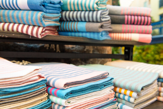 Striped rolls of fabric