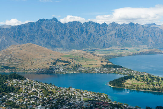 View from Bob's Peak above Queenstown township, Queenstown Gardens and Lake Wakatipu below and Remarkables Mountain Range beyond.