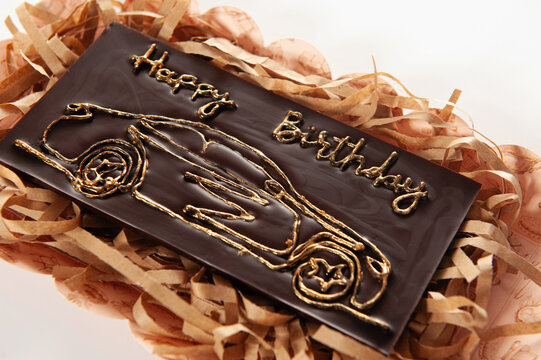 handmade chocolate with natural ingredients in the form of a bar, decorated with different types of chocolate decorations for a gift