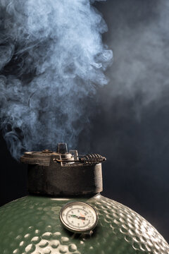 Steam coming out from an egg type grill