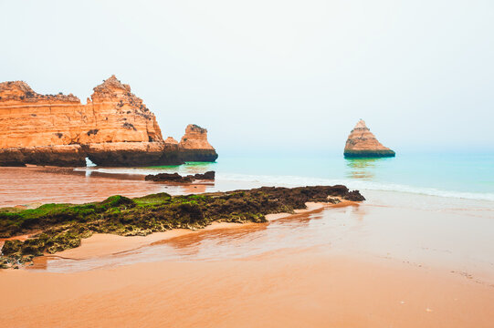 Rocks on the shore of Atlantic ocean in Algarve, Portugal. Beautiful summer seascape, famous travel destination