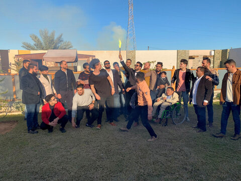 Malek Salem al-Mejae, who says he lost his leg in the 2011 revolution, takes a group photograph with his friends as he prepares for his wedding in Misrata