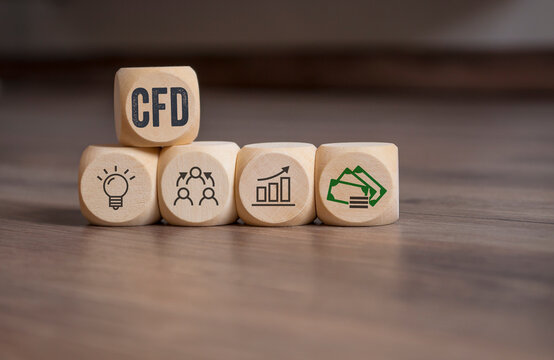 Cubes, dice or blocks with acronym CFD - Contracts For Difference on wooden background