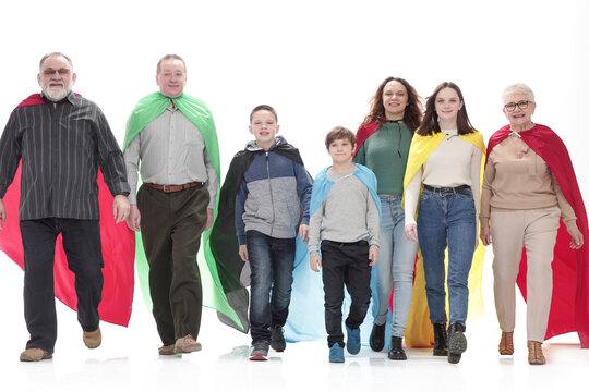 in full growth. happy family in superhero raincoats.