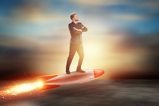 A man in a business suit, a businessman flies forward on a rocket. Mixed media. The concept of development, opportunities, goals, investments.