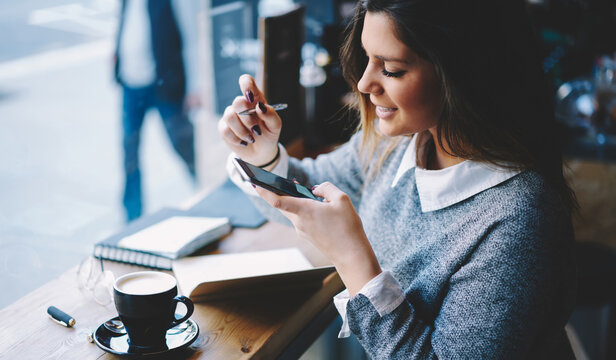 Happy woman typing message on smartphone