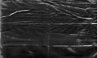 Obraz Background texture of a polyethylene,plastic transparent black plastic film,transparent stretched background - fototapety do salonu