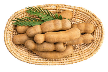 Fototapete - Top view pile of tamarind in bamboo tray with leaves on white background with clipping path.