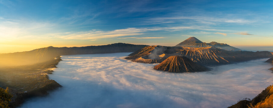 Bromo volcano mountai n at sunrise in East Java, Indonesia surrounded by morning fog.