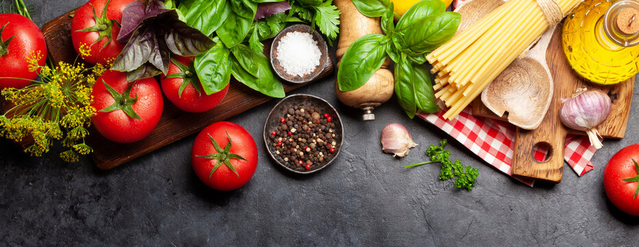 Italian cuisine ingredients. Tomatoes, pasta, herbs and spices