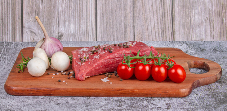 beef and vegetables on wood board