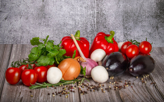group of different ripe vegetables on wooden table
