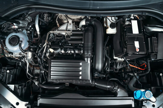 View under car hood at modern turbocharged eco-friendly engine or motor close up.