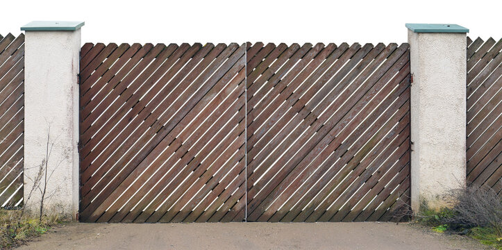 The gate of the country house is made of diagonally intersecting wooden planks isolated