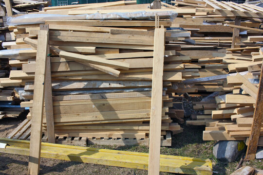 Many wooden planks at a construction site