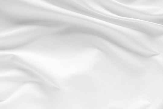 Abstract white fabric texture background. Cloth soft wave. Creases of satin. silk and cotton.