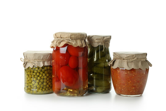Jars with different canned food isolated on white background