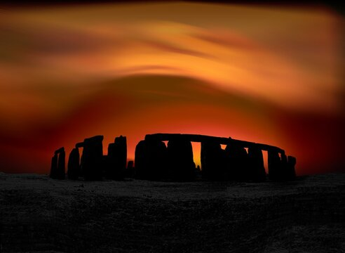 stylized megalith silhouetted against dramatic evening sky