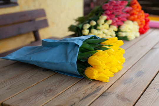 Bouquet of multi-colored tulips on a wooden background. View from above. Valentine's Day, Women's Day, Mother's Day