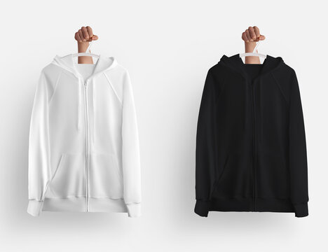 Mockup of white, black hoodie with zipper closure, pockets hanging on a hanger in hand, blank long sleeve clothes isolated on background.