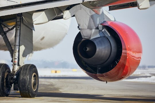 Hot air behind jet engine of plane at airport. Commercial airplane taxiing to runway before take off.