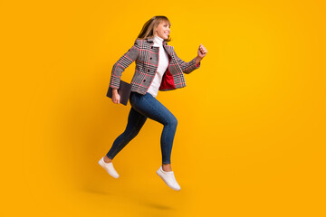 Wall Mural - Full length profile photo of pretty carefree person running look empty space isolated on yellow color background