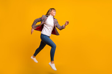 Wall Mural - Full length profile portrait of active pretty person running look empty space isolated on yellow color background