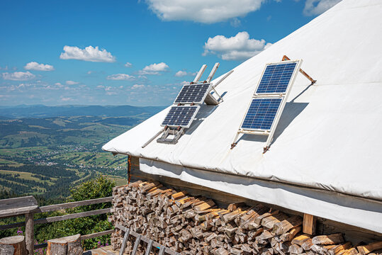 Small solar panels on the roof of a village house.