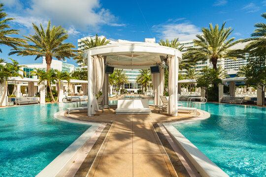 The beautiful pool area of the historic art deco Fontainebleau Hotel in Miami Beach, Florida