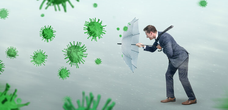 Businessman opposing a conceptual storm of viruses